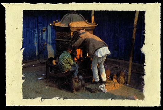 Praying, Tanhiti Tole, Kathmandu, Nepal, 2001.