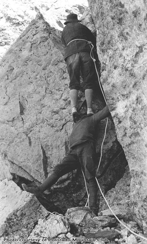 "Albert Ellingwood doing a ""Courte-echelle"" with Carl Blaurock, circa 1920. Photo courtesy of the Colorado Mountain Club."