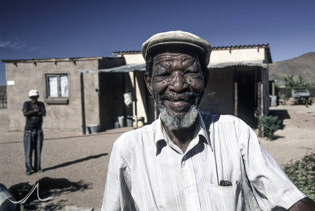Peter Lord - a former Damara exilee in Namibia - smiles, happy to be back home in Riemvasmaak, South Africa.
