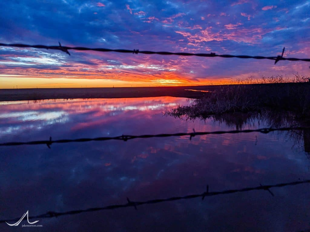 Sunset and barbed wire over West Texas.