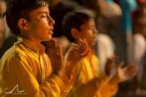 The faithful perform Ganga Aarti, a puja to the Ganges, at the Parmarth Niketan Ashram in Rishikesh, Uttarakhand, India.