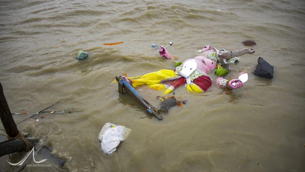 A pandal, or statue, floats in the Ganges during Durga Puja.