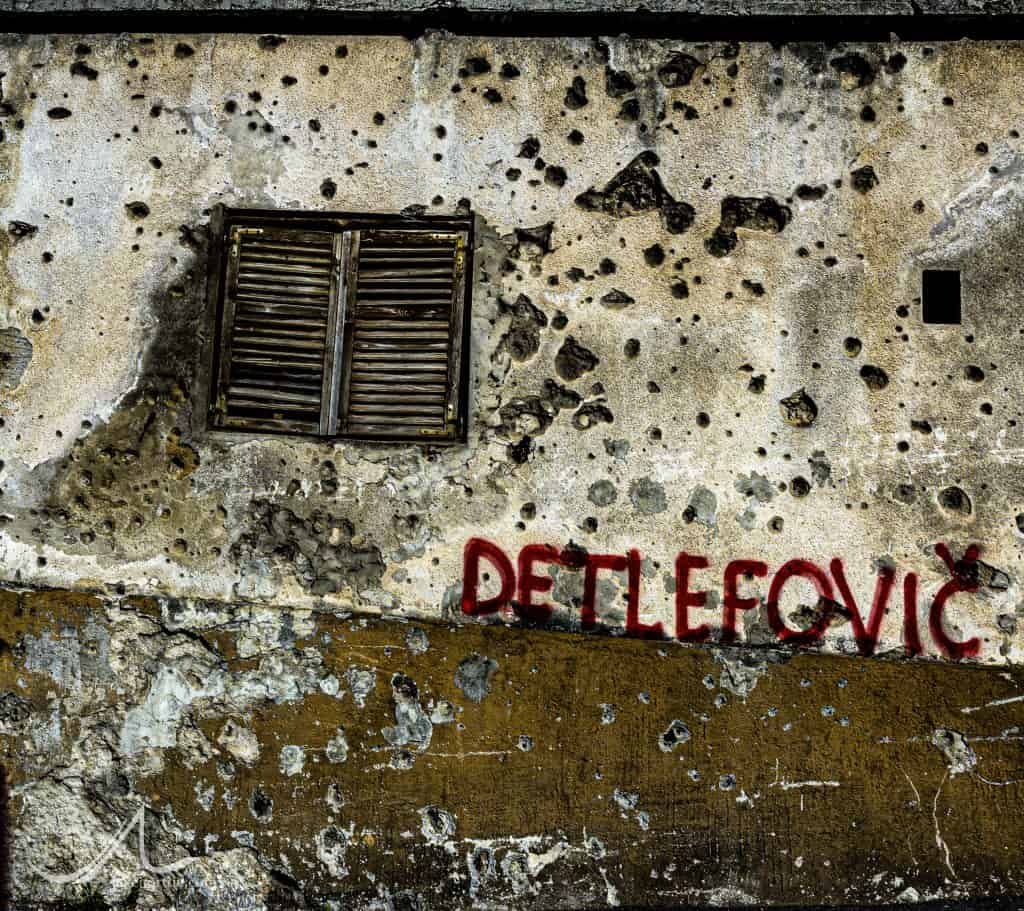 A wall riddled with bullet holes from the 1993 Siege of Mostar in Mostar, Bosnia and Herzegovina.