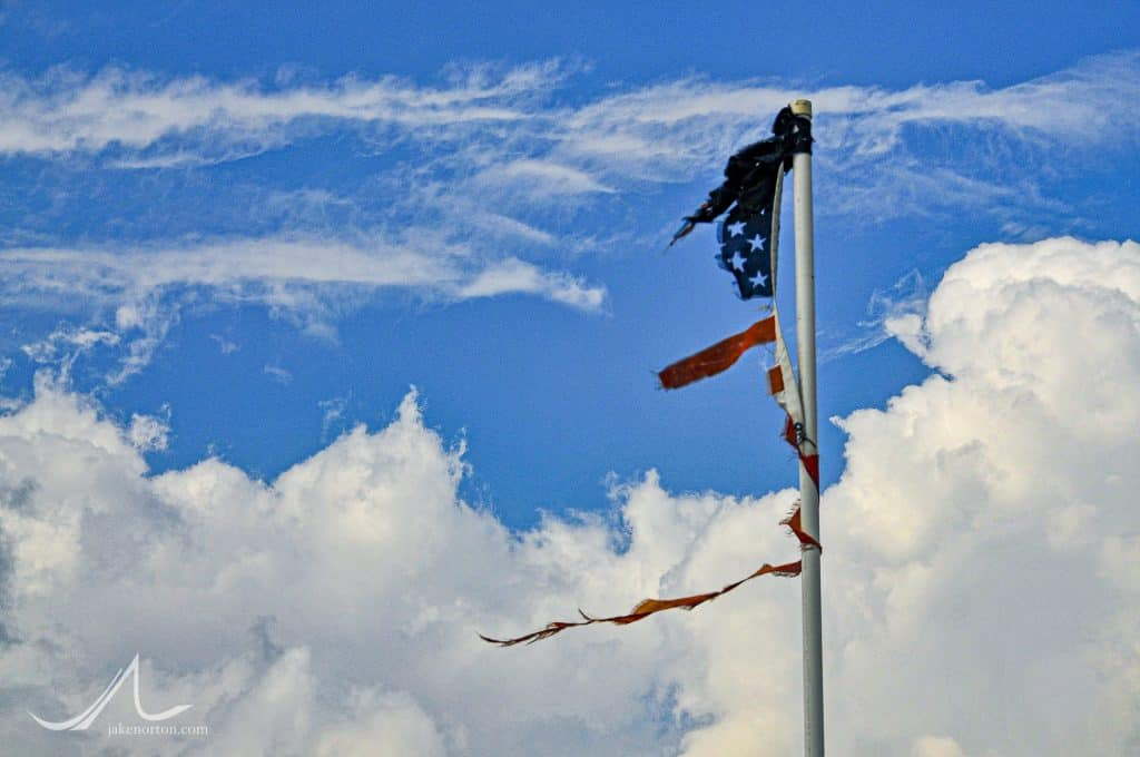A tattered American flag - having survived Hurricane Gustav - still flies over the bayou of Cocodrie, Louisiana, near Houma.