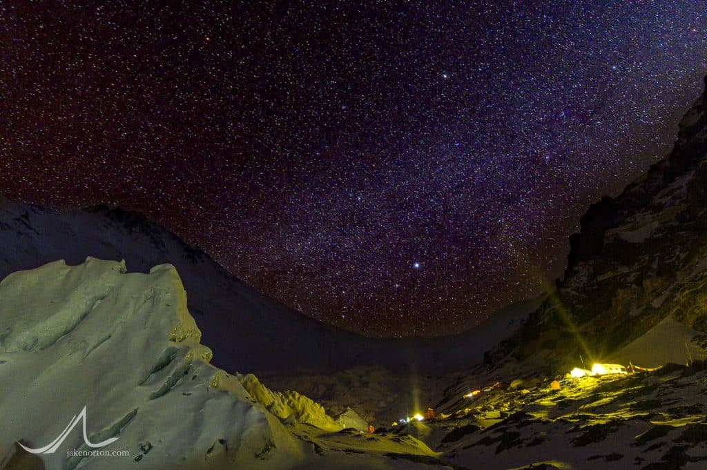 Stars and a bit of the Milky Way rise above Advanced Basecamp and the North Ridge of Mount Everest, Tibet.