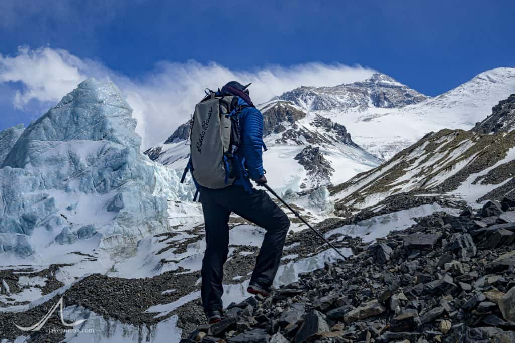 Sid Pattison gazes at the North Face of Mount Everest rising above seracs at 20,500 feet on the East Rongbuk Glacier, Tibet.