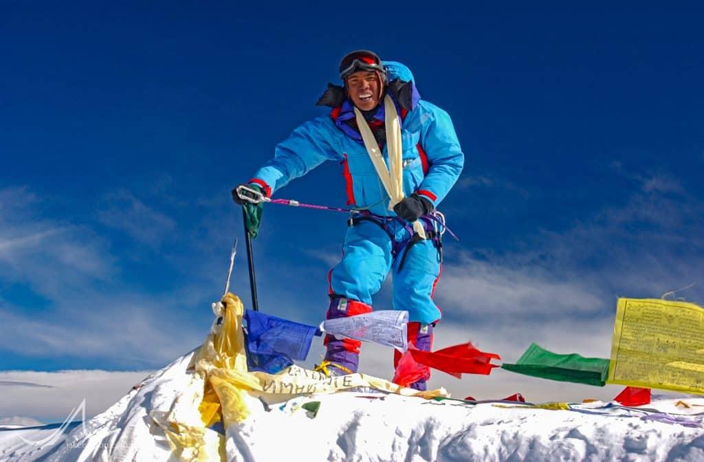 Karma Rita Sherpa on the summit of Mount Everest, May 18, 2002.