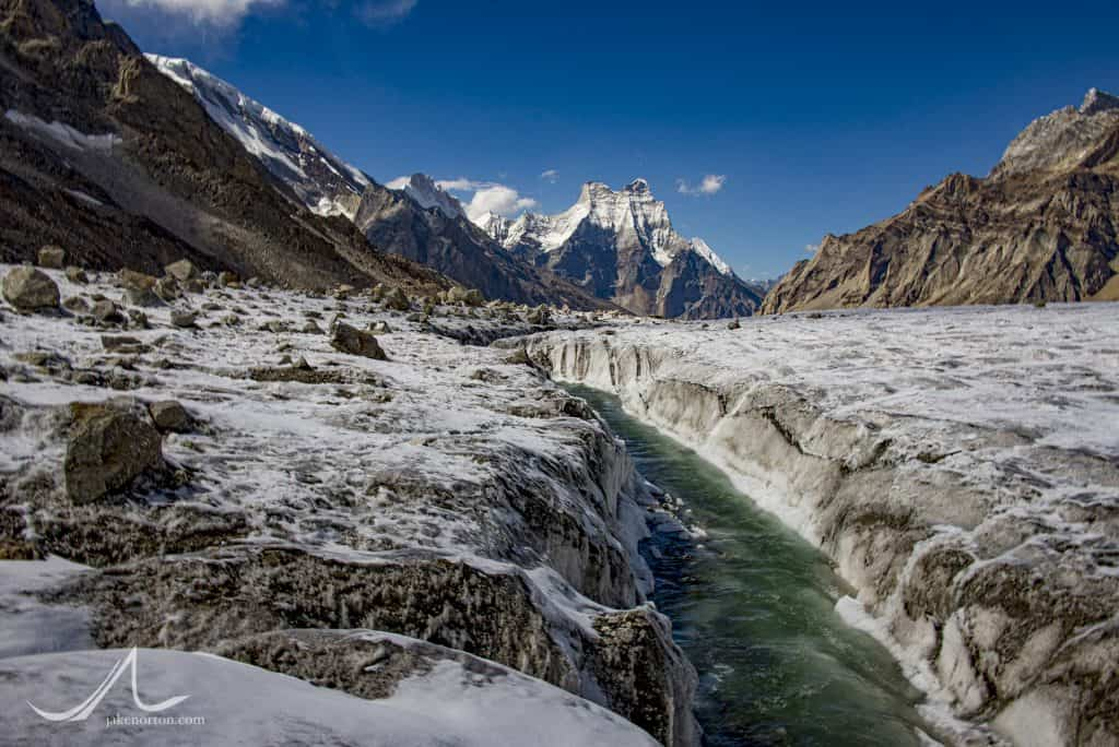 The first waters of the Bhagirathi (Ganges) River flow atop the Gangotri Glacier at over 17,000 feet. Shivling rises down valley.