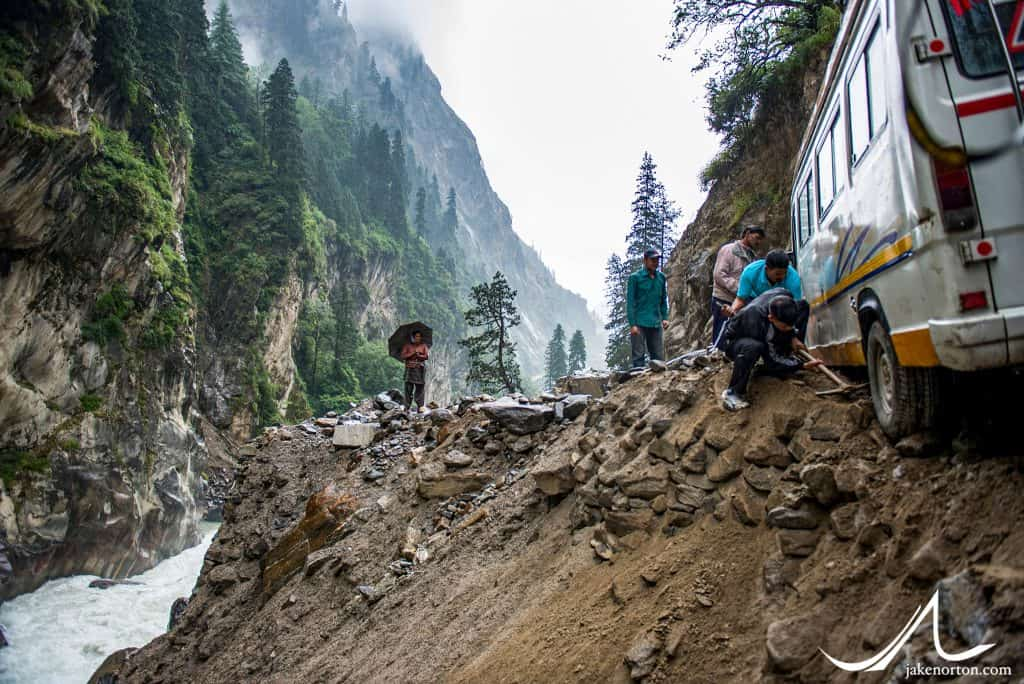 "A bus nearly topples off the road below Gangotri. The ""Himalayan Tsunami"" of 2013 washed out roads and caused massive, destructive flooding across North India, including this, the only road connecting Gangotri to the valleys below."
